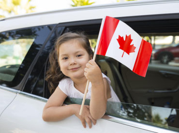 girl-holding-canadian-flag-solidcolours